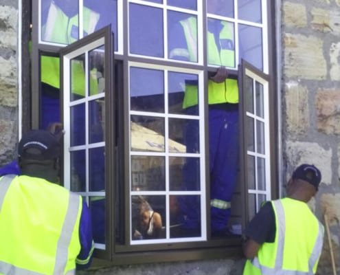 Table Mountain Heritage - Man Working - Metal Window